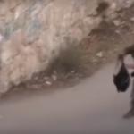 قوات الاحتلال تفتش حقيبة مدرسية لطفلة فلسطينية في الخليلIsraeli troops searching a school bag of a Palestinian child in Hebron